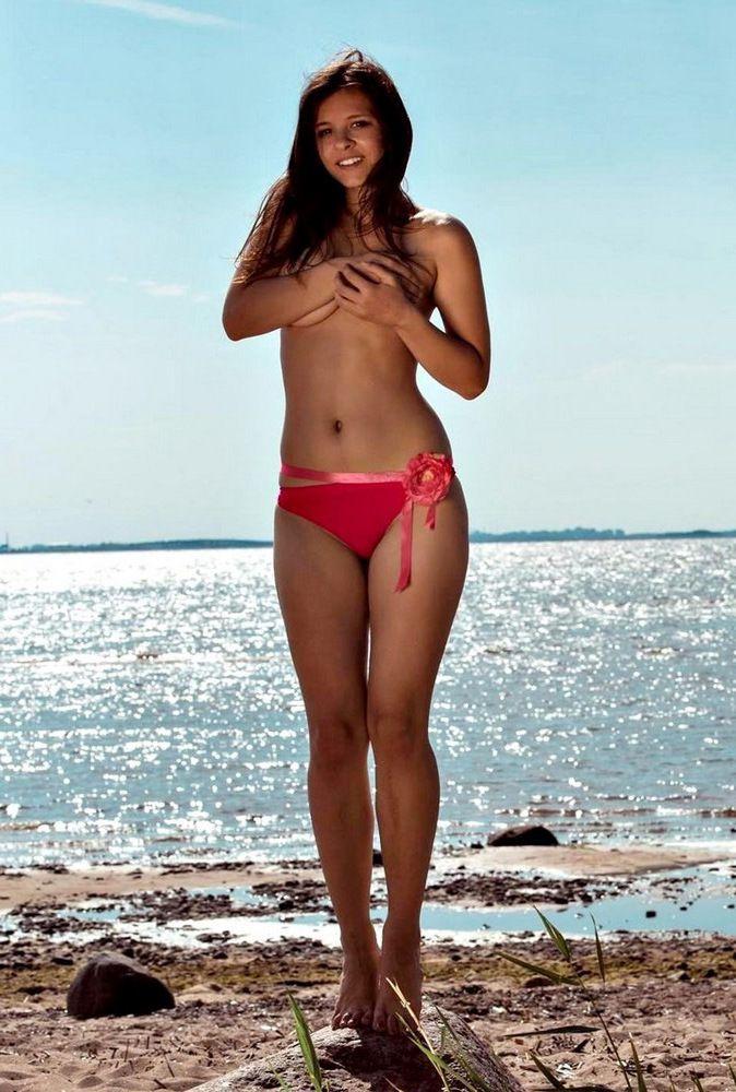 Nubile model in crimson bikini,..